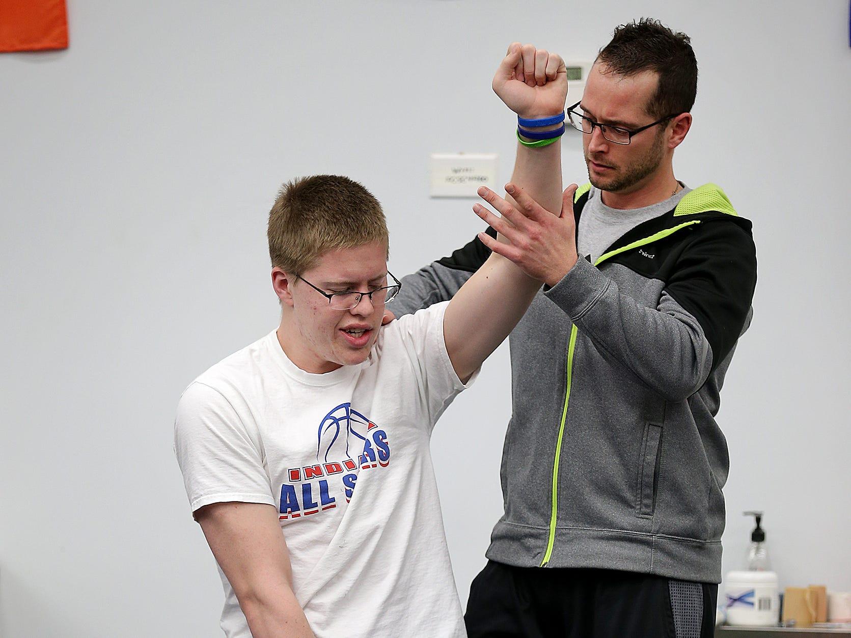 Columbus North basketball star Josh Speidel works on he rehab with rehab trainer Nate Frasier at Maximum Velocity Performance in Columbus in 2016.