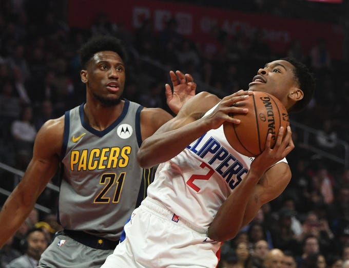 Mar 19, 2019; Los Angeles, CA, USA; LA Clippers guard Shai Gilgeous-Alexander (2) shoots against Indiana Pacers forward Thaddeus Young (21) in the first half at the Staples Center.