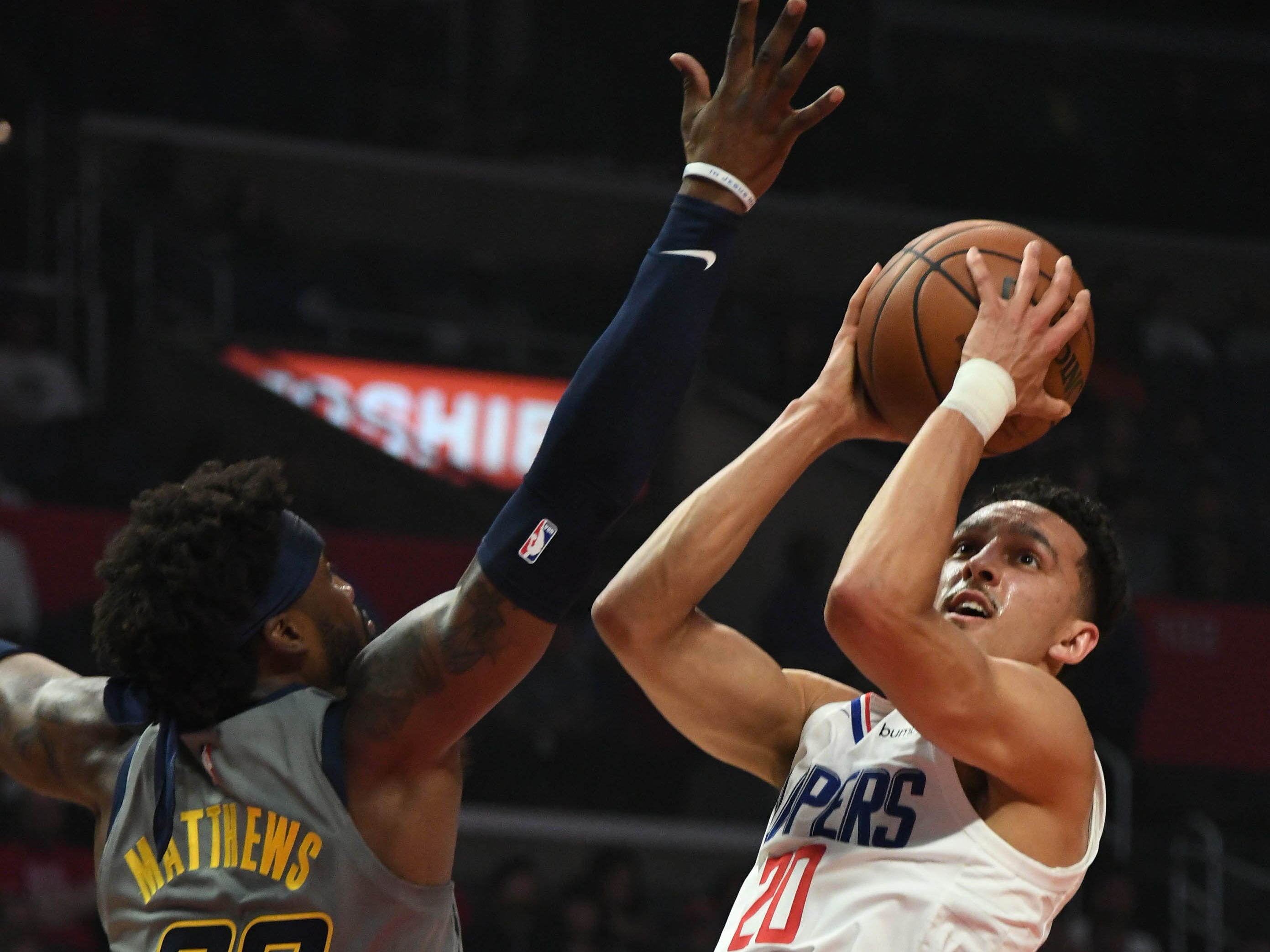Mar 19, 2019; Los Angeles, CA, USA;  LA Clippers guard Landry Shamet (20) shoots over Indiana Pacers guard Wesley Matthews (23) in the first half at the Staples Center.