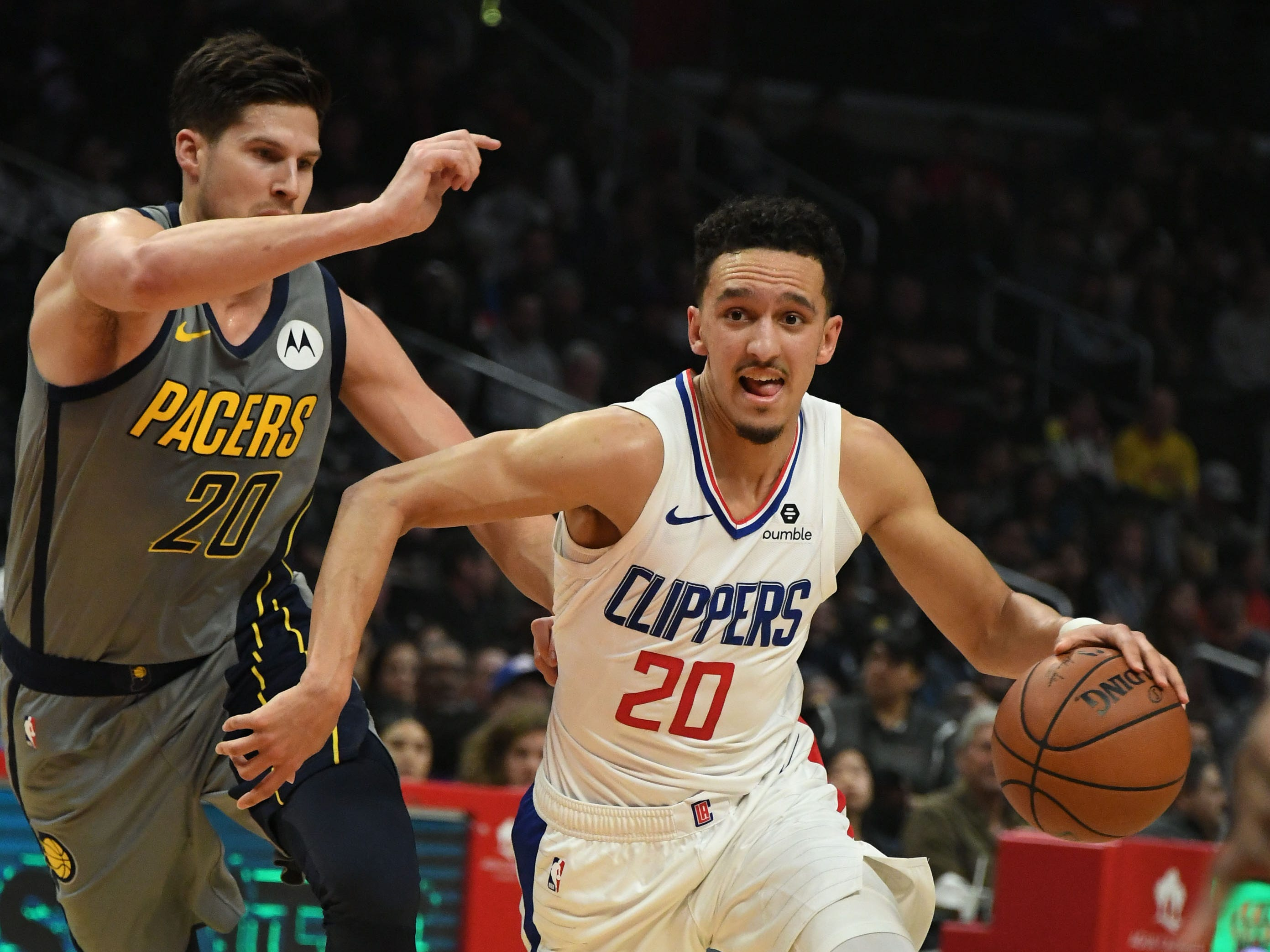 Mar 19, 2019; Los Angeles, CA, USA;  LA Clippers guard Landry Shamet (20) drives to the basket against Indiana Pacers forward Doug McDermott (20) in the first half at the Staples Center.
