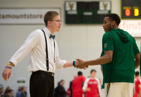 Josh Speidel greeted the University of Vermont's Darren Payen during warm-ups before the second half against Stony Brook in Burlington in 2016.