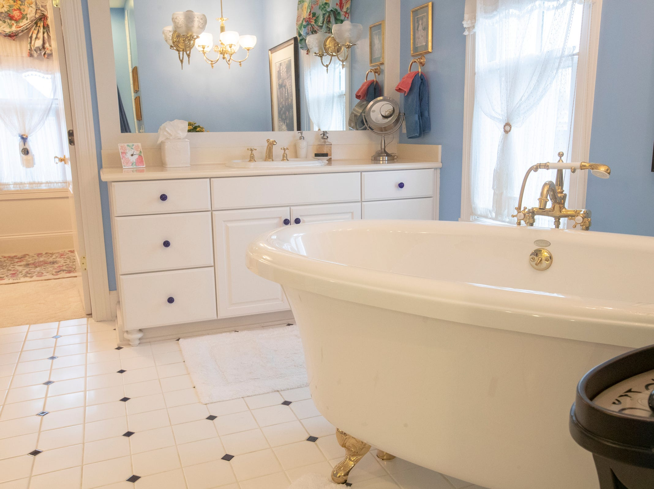 A free-standing bathtub in the master bathroom of a thirteen-year-old Victorian home in the Village of West Clay, Carmel, March 20, 2019. The house includes 16 rooms with five bedrooms, 8,348 square feet, and is listed at $1.275 million.