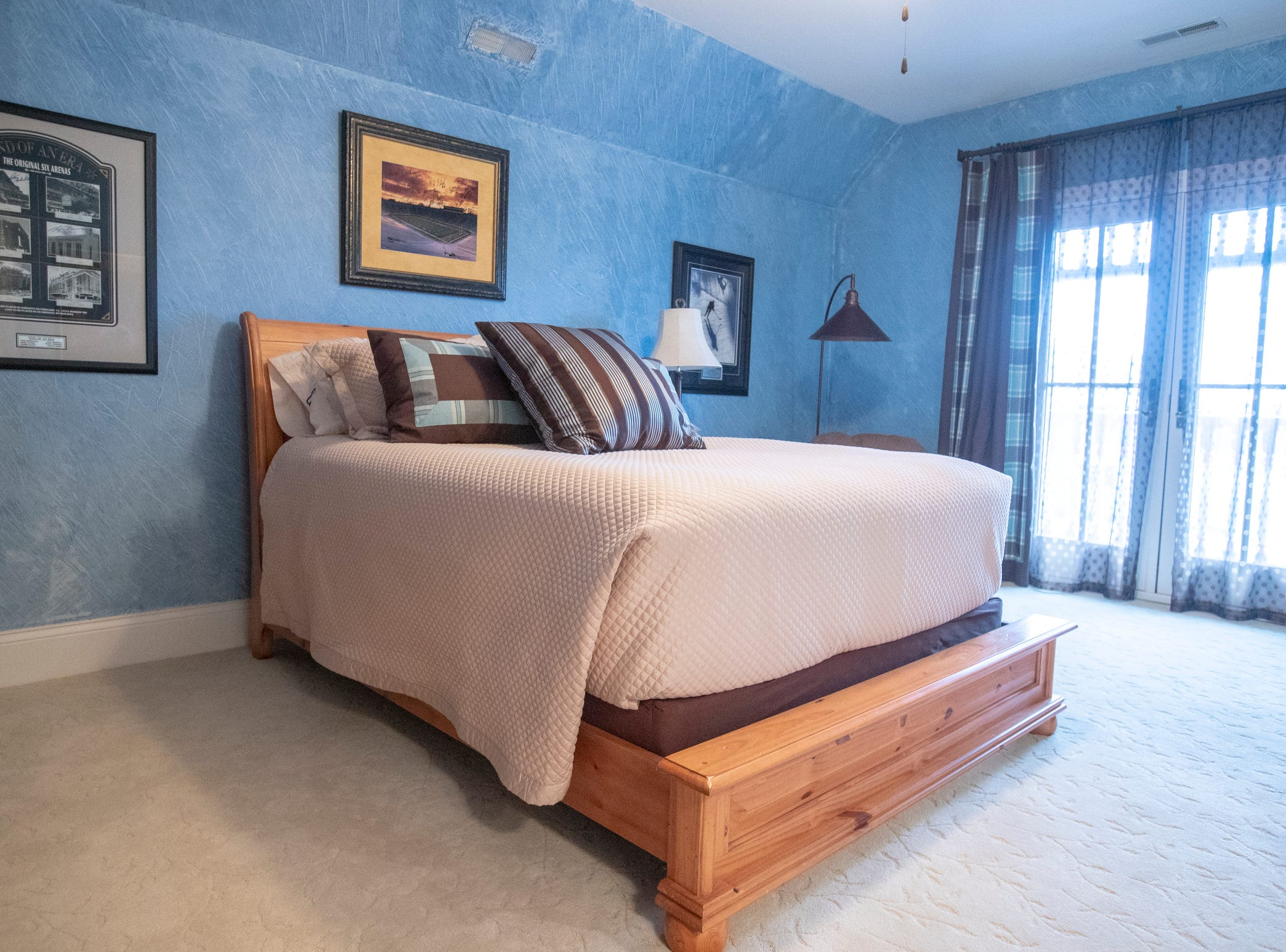 One of the bedrooms in a thirteen-year-old Victorian home in the Village of West Clay, Carmel, March 20, 2019. The house includes 16 rooms with five bedrooms, 8,348 square feet, and is listed at $1.275 million.