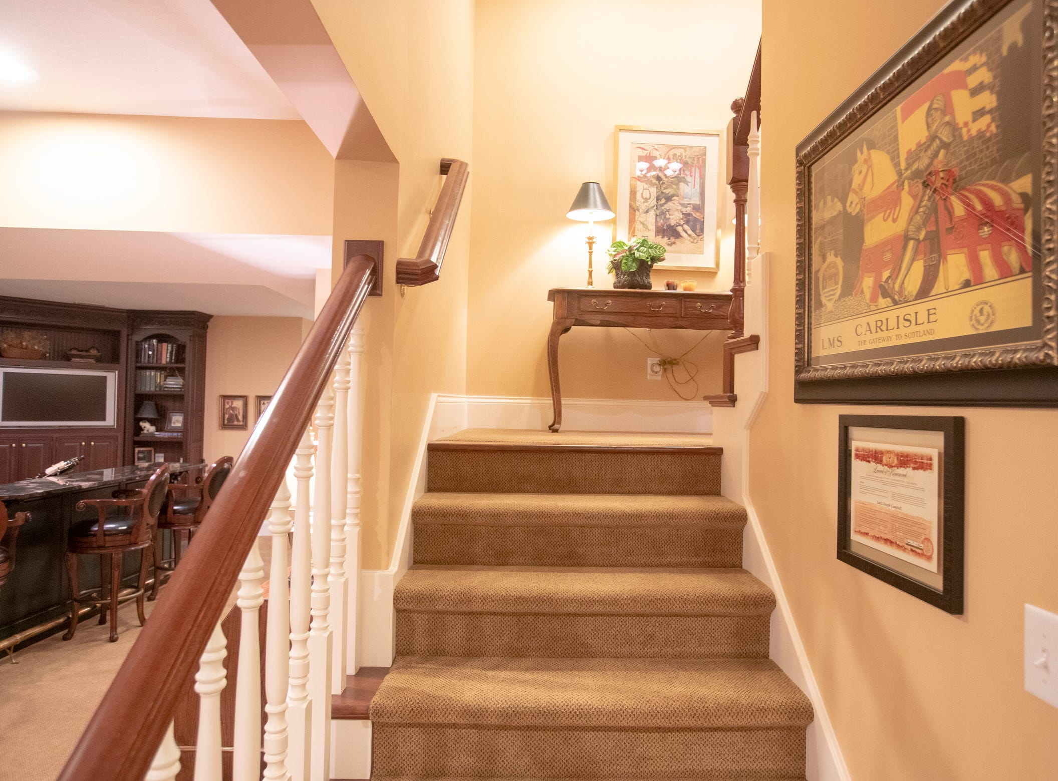 The stairway leading up from the basement inside of a thirteen-year-old Victorian home in the Village of West Clay, Carmel, March 20, 2019. The house includes 16 rooms with five bedrooms, 8,348 square feet, and is listed at $1.275 million.