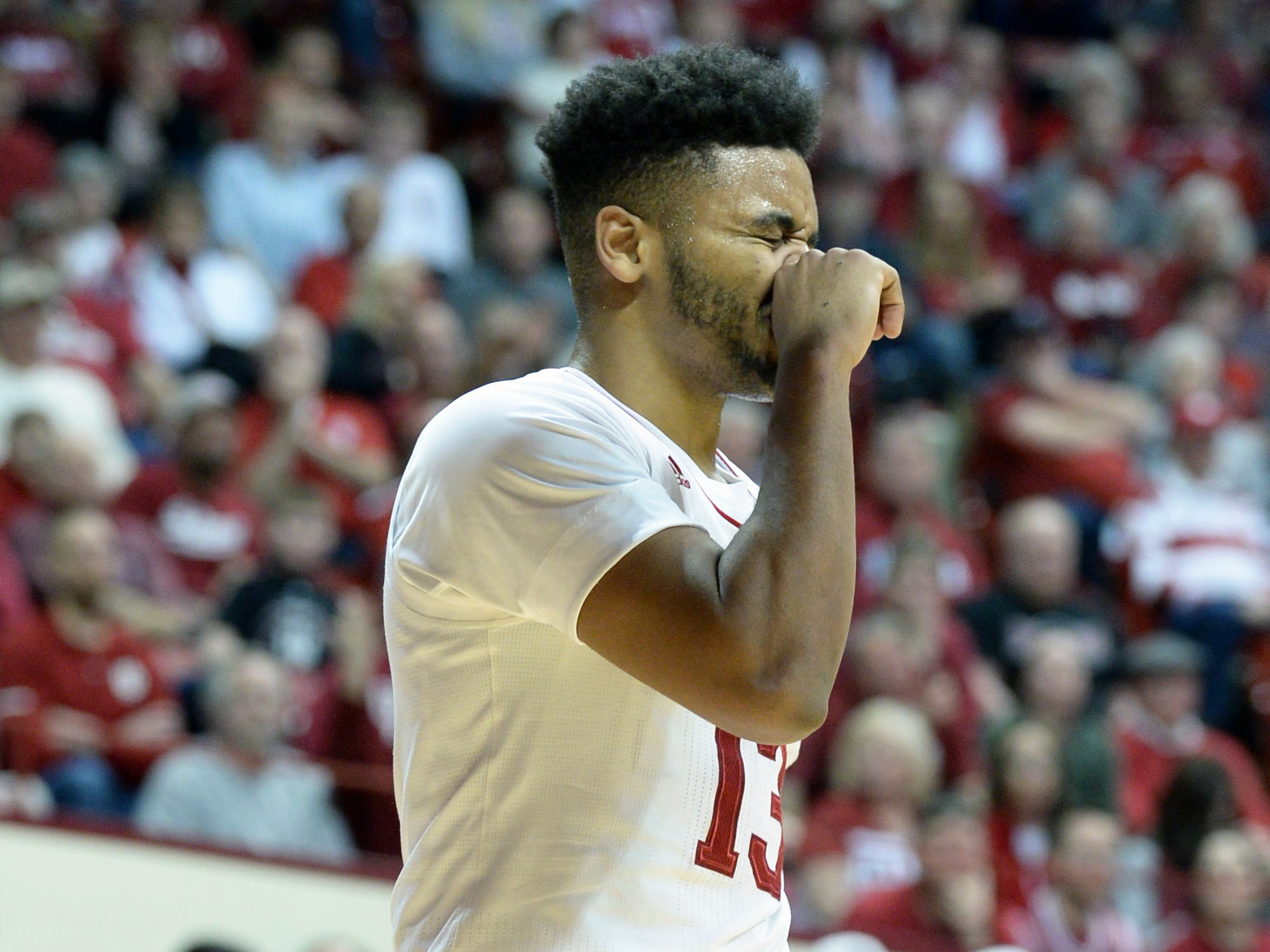 Indiana Hoosiers forward Juwan Morgan (13) rubs his face after being fouled during the game against St. Francis (Pa.) at Simon Skjodt Assembly Hall in Bloomington Ind., on Tuesday, March 19, 2019.