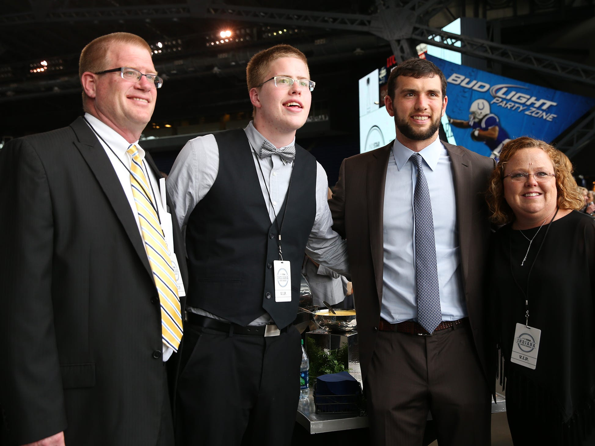 Colts' quarterback Andrew Luck poses for a picture with David and Lisa Speidel along with their son, Josh, before the  IndyStar Sports Awards, April 28, 2016 at Lucas Oil Stadium.