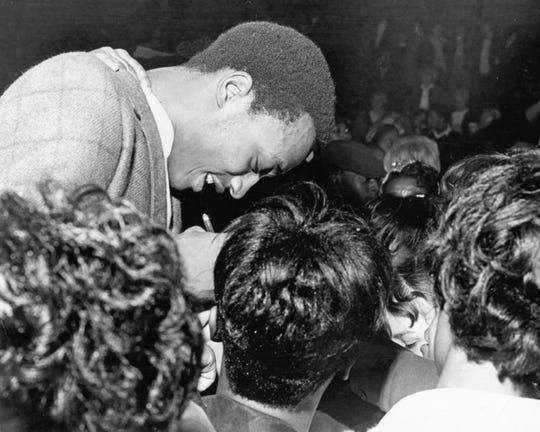 Washington High School's George McGinnis is mobbed by autograph seekers after a game in March 1969.
