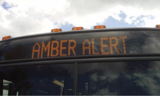 Amber Alert flashes on route sign of bus.
