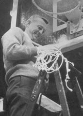 Bill Green cuts down the net after Washington defeated Silver Springs to win the 1969 semistate.