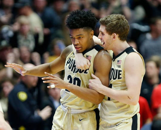 Nojel Eastern of Purdue celebrates with Ryan Cline after blocking the shot of Anthony Cowan Jr. of Maryland as time expires, December 6, 2018, at Mackey Arena. Purdue defeated Maryland 62-60.