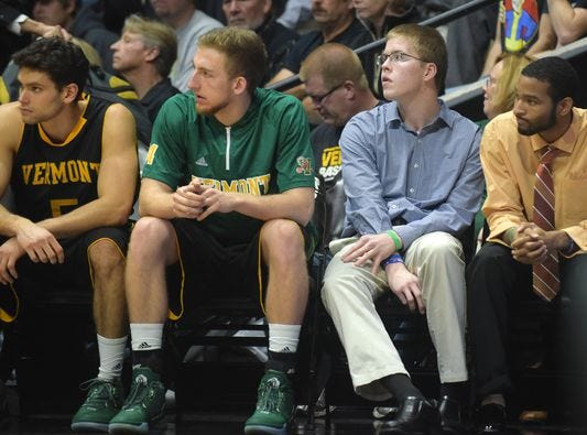 Josh Speidel (third from left) sits with the Catamounts during their game at Purdue. A head injury prevented him from playing with them this season.