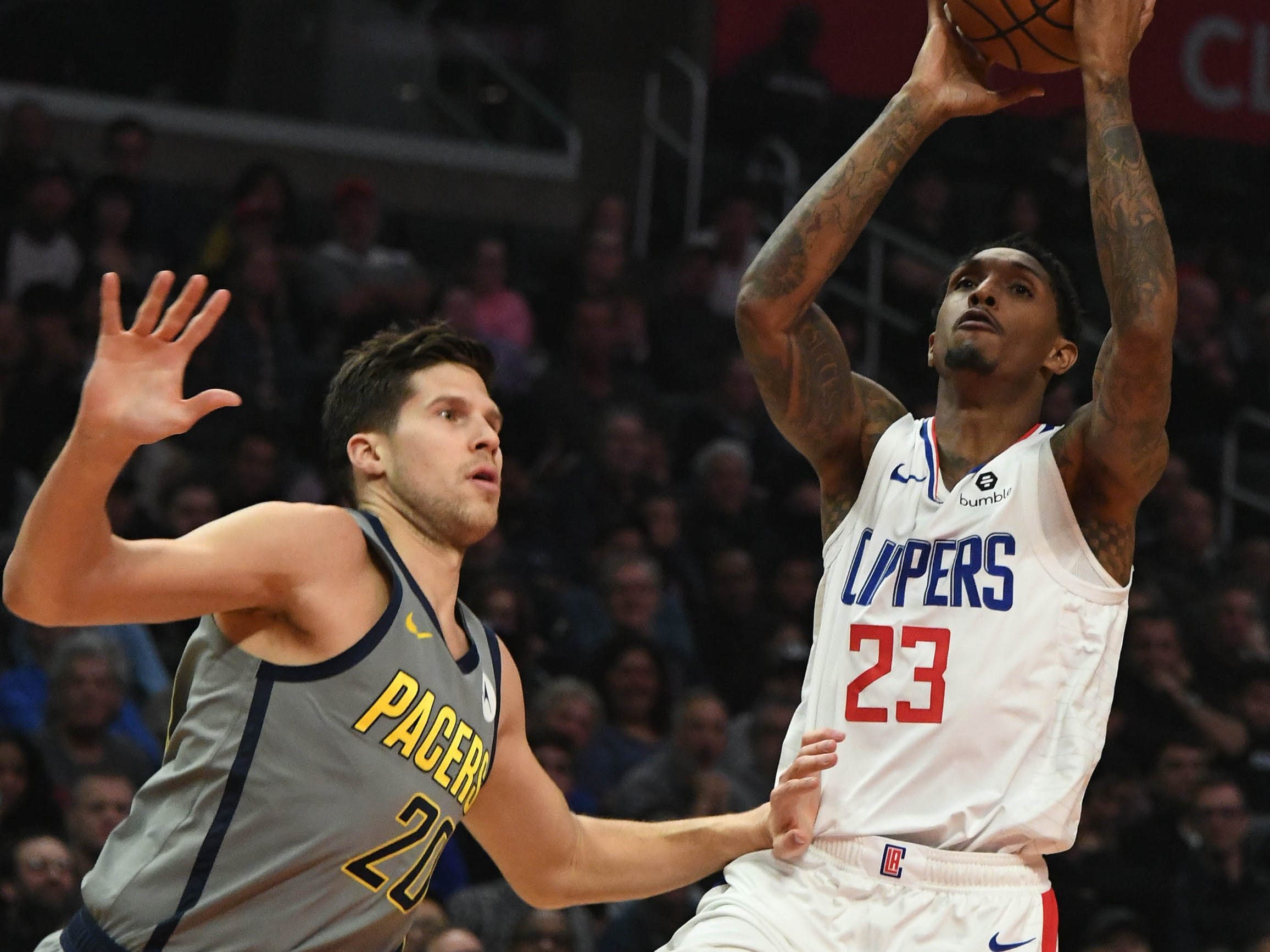 Mar 19, 2019; Los Angeles, CA, USA; LA Clippers guard Lou Williams (23) shoots against Indiana Pacers forward Doug McDermott (20) in the first half at the Staples Center.