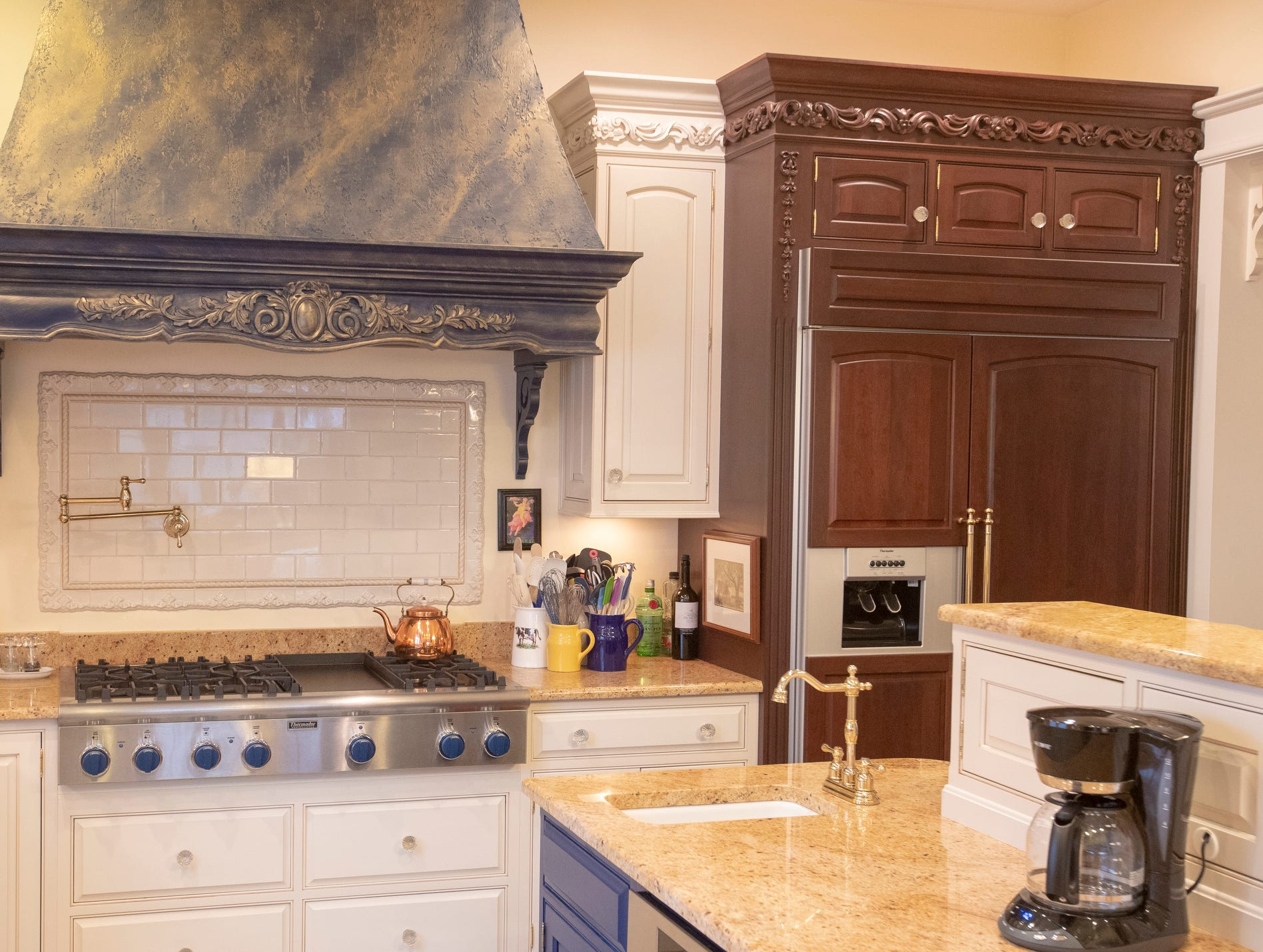 The oven and refrigerator area inside a thirteen-year-old Victorian home in the Village of West Clay, Carmel, March 20, 2019. The house includes 16 rooms with five bedrooms, 8,348 square feet, and is listed at $1.275 million.