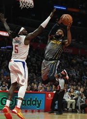 Mar 19, 2019; Los Angeles, CA, USA; Indiana Pacers guard Tyreke Evans (12) shoots against LA Clippers forward Montrezl Harrell (5) in the second half at the Staples Center. Mandatory Credit: Richard Mackson-USA TODAY Sports