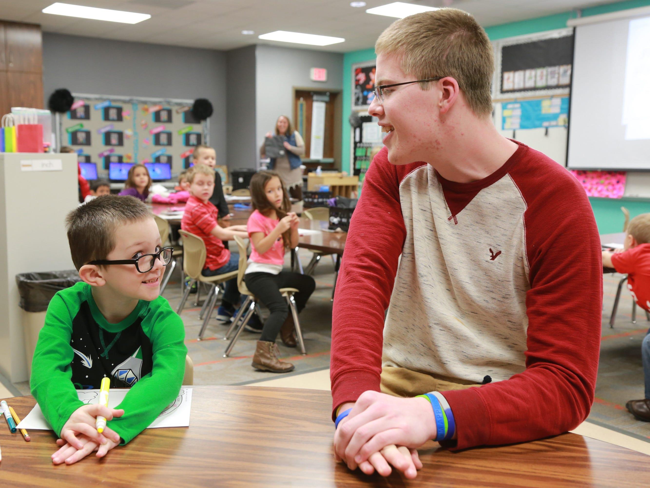 Former Columbus North basketball player Josh Speidel  has volunteered at  Brown Elementary in Seymour.