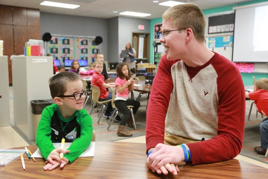 Former Columbus North basketball player Josh Speidel  has volunteered at  Brown Elementary in Seymour.