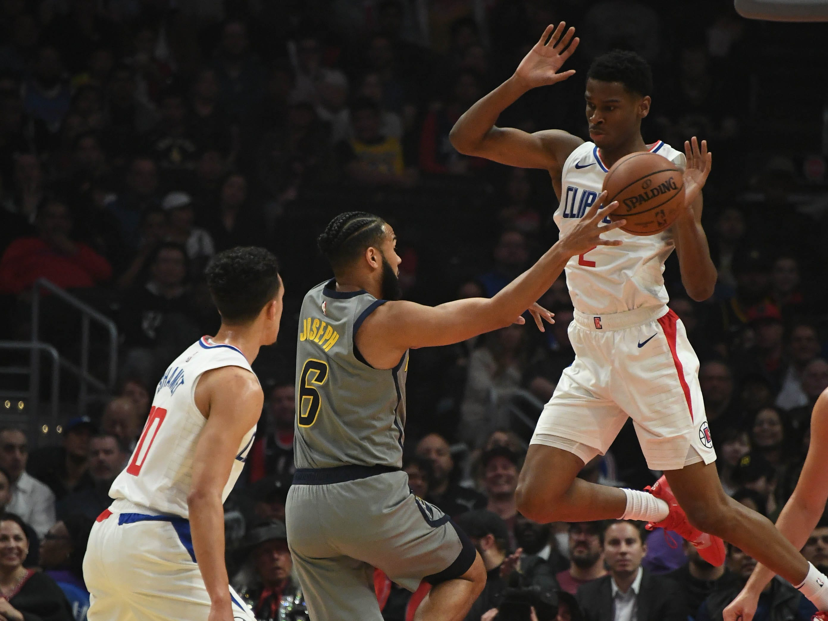 Mar 19, 2019; Los Angeles, CA, USA; Indiana Pacers guard Cory Joseph (6) passes the ball away from LA Clippers guard Shai Gilgeous-Alexander (2)  in the first half at the Staples Center.
