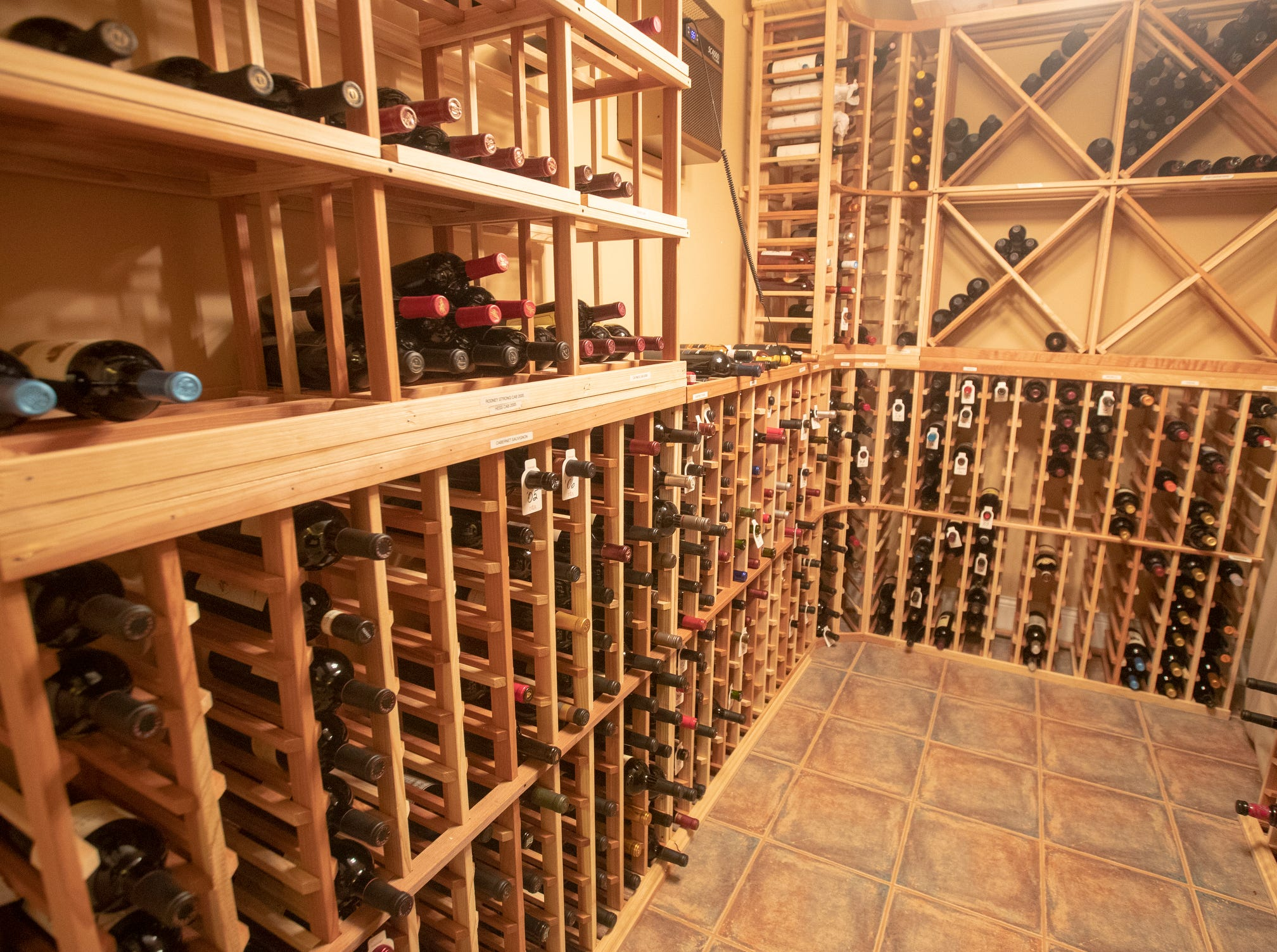 The wine cellar in the basement of a thirteen-year-old Victorian home in the Village of West Clay, Carmel, March 20, 2019. The house includes 16 rooms with five bedrooms, 8,348 square feet, and is listed at $1.275 million.