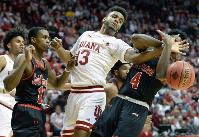 Indiana Hoosiers forward Juwan Morgan (13) fights for a rebound during the game against St. Francis (Pa.) at Simon Skjodt Assembly Hall in Bloomington Ind., on Tuesday, March 19, 2019.