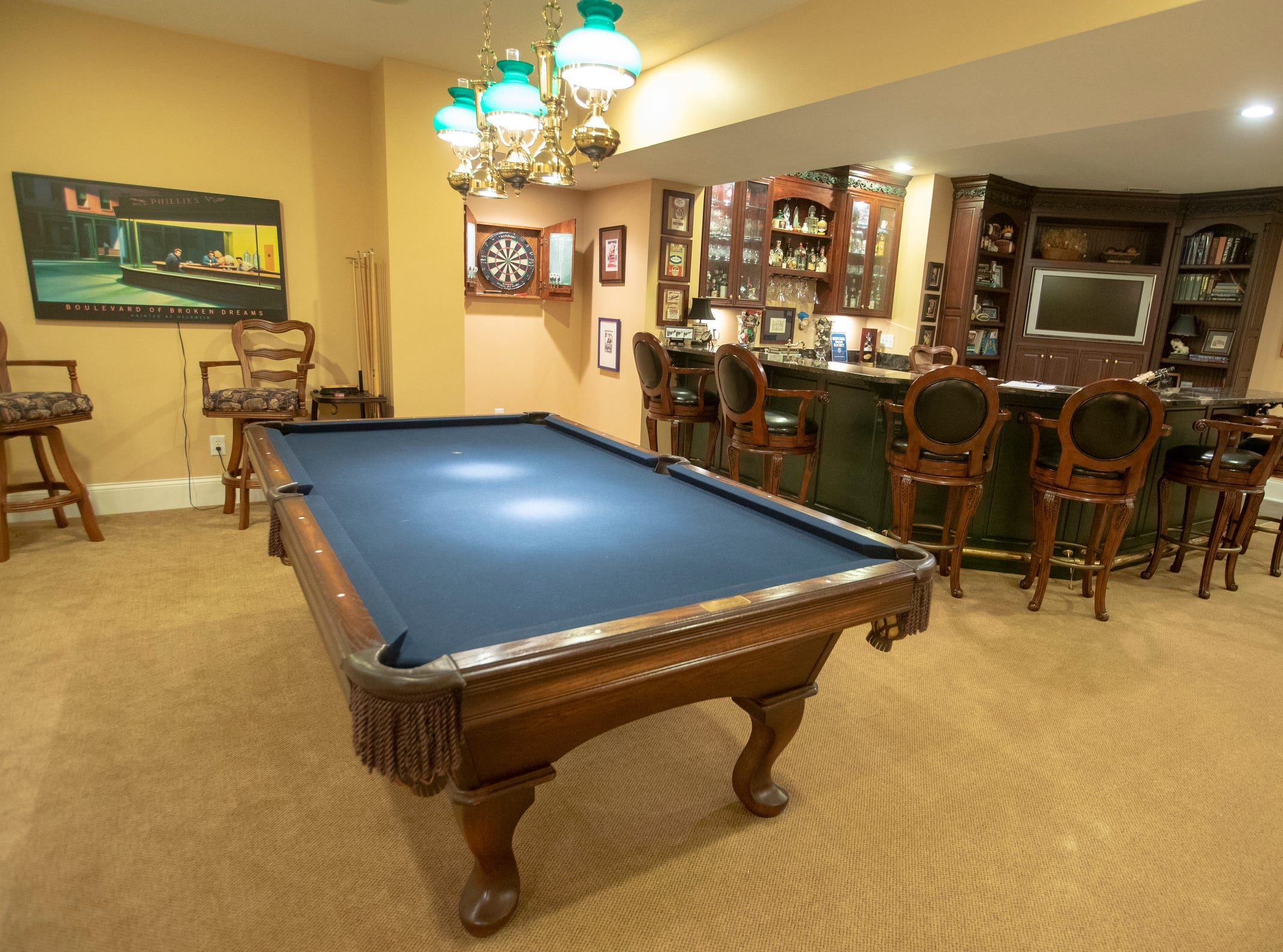 A basement game room inside a thirteen-year-old Victorian home in the Village of West Clay, Carmel, March 20, 2019. The house includes 16 rooms with five bedrooms, 8,348 square feet, and is listed at $1.275 million.