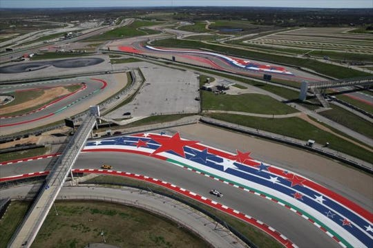 Andretti Autosport drivers Ryan Hunter-Reay and Marco Andretti drive around the Circuit of the Americas road course during IndyCar's open test in February.