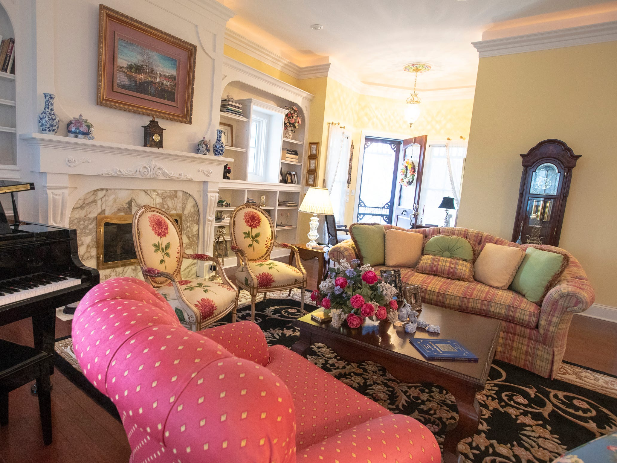 The front room inside a thirteen-year-old Victorian home in the Village of West Clay, Carmel, March 20, 2019. The house includes 16 rooms with five bedrooms, 8,348 square feet, and is listed at $1.275 million.