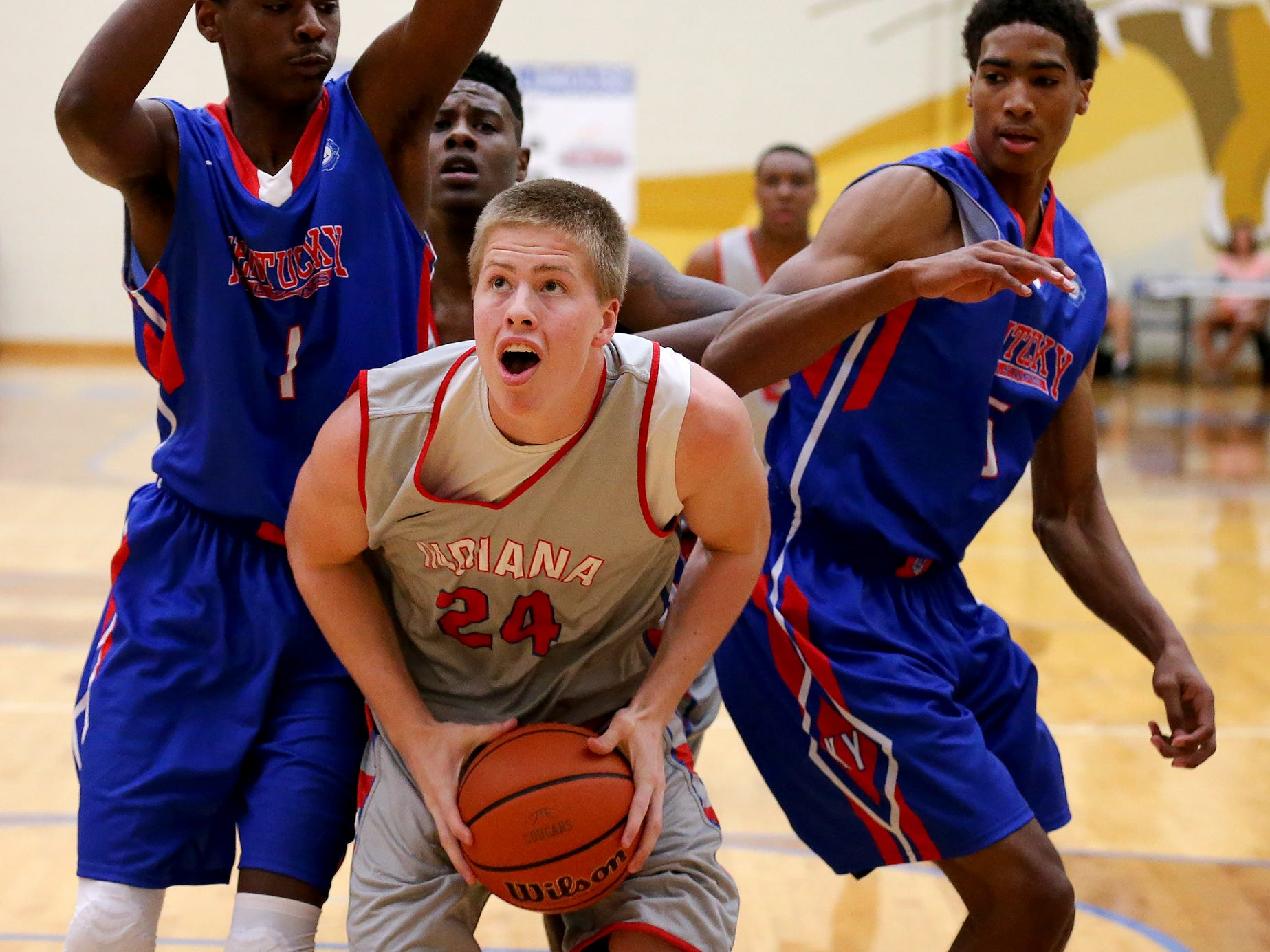 Indiana's Josh Speidel gets the ball under the basket against Kentucky during the Junior All-Star Game, Friday, June 6, 2014, at Greenfield Central High School. Indiana won the game 127-104.