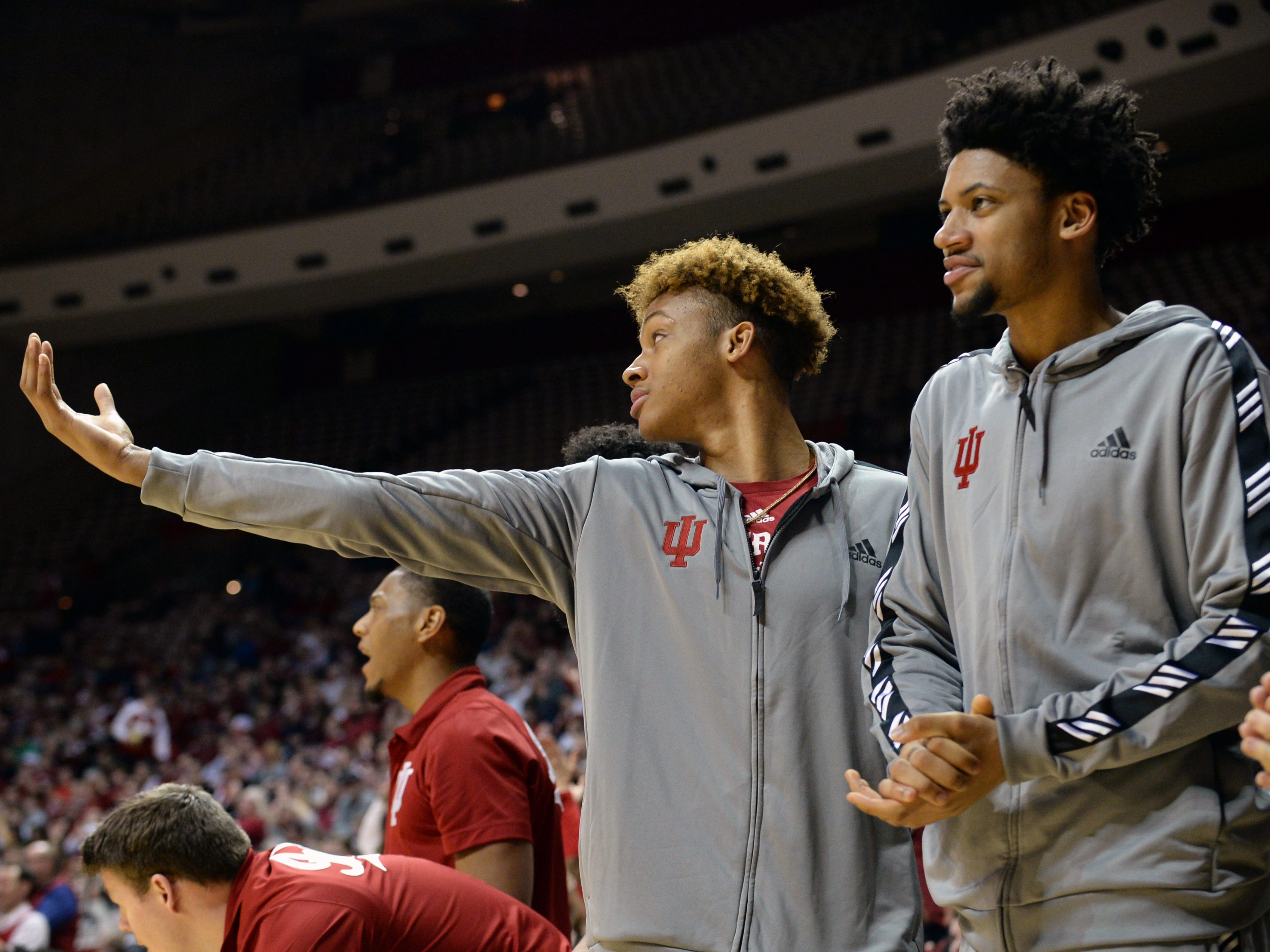 Hoosiers guard Romeo Langford (left) and forward Jerome Hunter cheer from the bench during IU's win over Saint Francis on Tuesday.