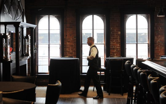 Arched windows throw light onto cozy 1933 Lounge above St. Elmo Steak House in Downtown Indianapolis. The popular bar's next location is planned for The Yard at Fishers District, a food-centric plaza and outdoor mall scheduled to start opening restaurants in fall 2019.