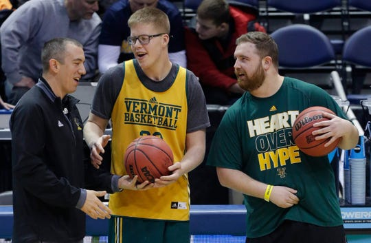 Vermont forward Josh Speidel (center) talks with team personnel during practice before the first round of the NCAA Division I Men's Basketball Championship in 2017 at BMO Harris Bradley Center in Milwaukee.