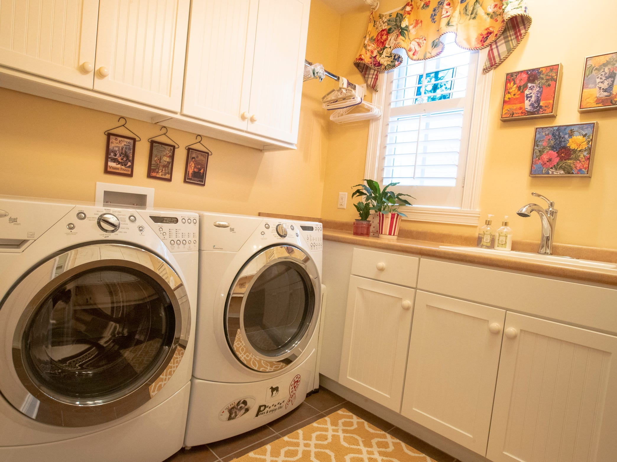 A laundry room inside a thirteen-year-old Victorian home in the Village of West Clay, Carmel, March 20, 2019. The house includes 16 rooms with five bedrooms, 8,348 square feet, and is listed at $1.275 million.