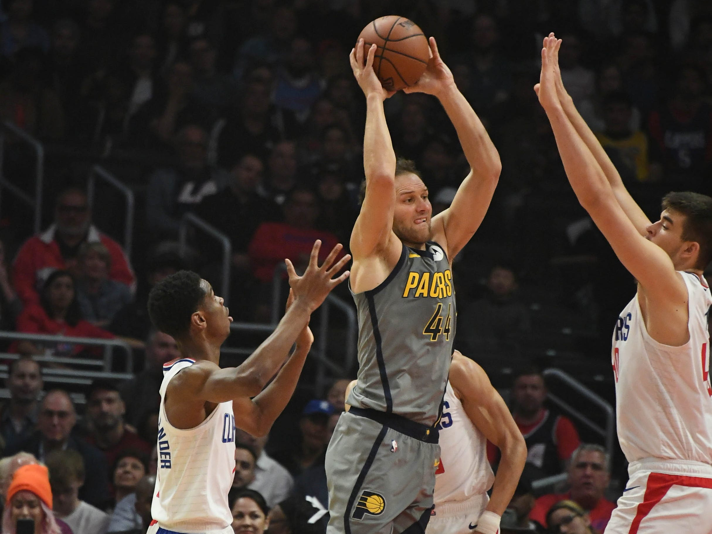 Mar 19, 2019; Los Angeles, CA, USA; Indiana Pacers forward Bojan Bogdanovic (44) passes the ball away from LA Clippers center Ivica Zubac (right) in the first half at the Staples Center.