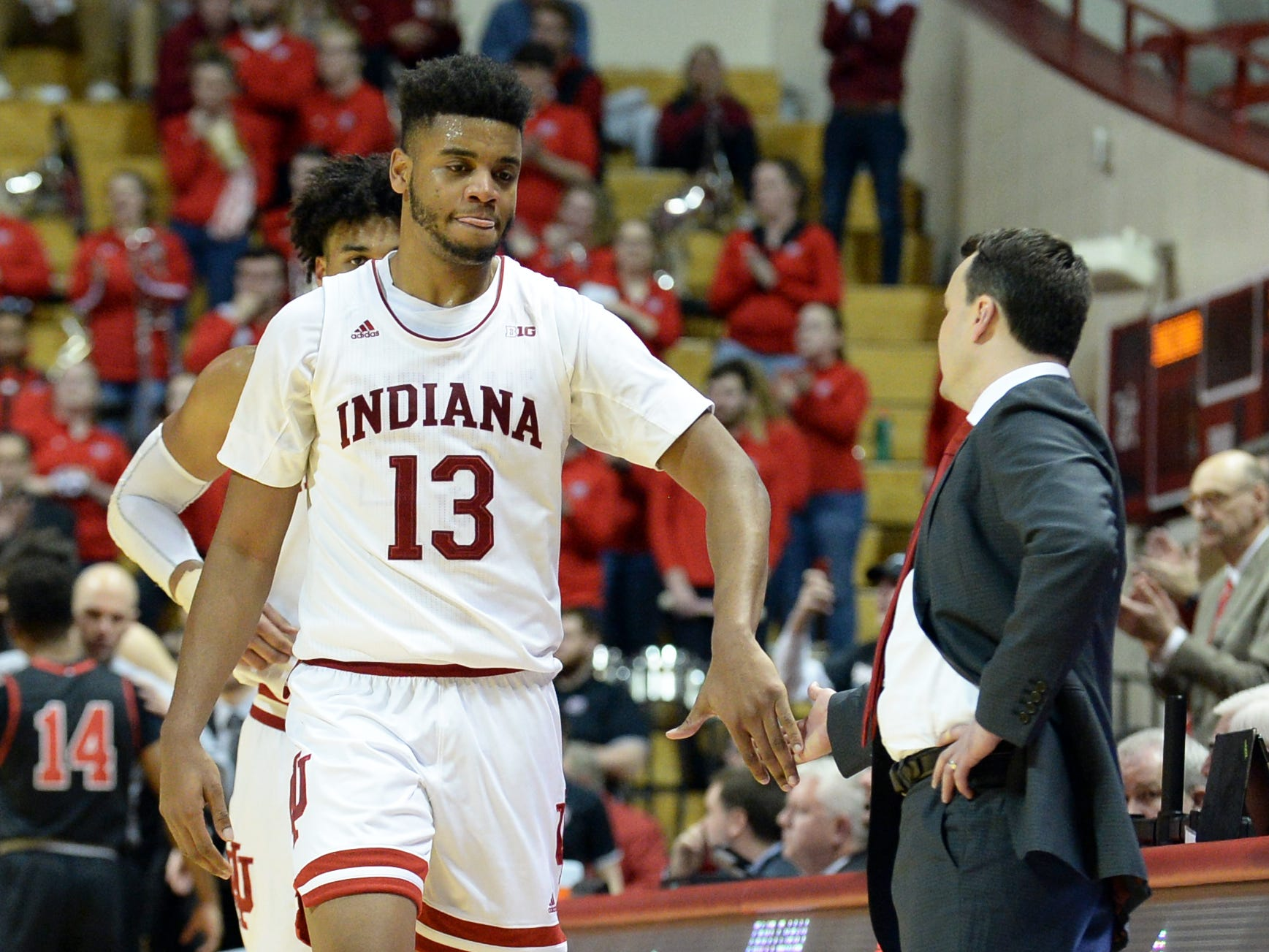Indiana Hoosiers forward Juwan Morgan (13) receives a high five from Indiana Hoosiers head coach Archie Miller during the game against St. Francis (Pa.) at Simon Skjodt Assembly Hall in Bloomington Ind., on Tuesday, March 19, 2019.