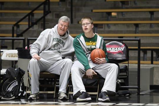 Vermont's Josh Speidel sits with former Catamounts head coach Tom Brennan at Purdue's Mackey Arena
