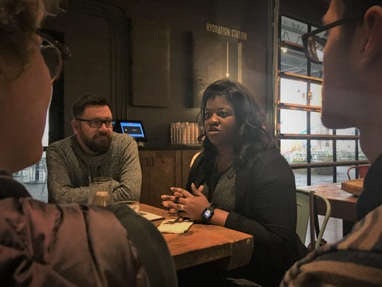 Deidre DeJear, the chair of 2020 presidential candidate Kamala Harris' Iowa campaign, speaking with voters Tuesday, March 19 at Big Grove Brewery in Iowa City.