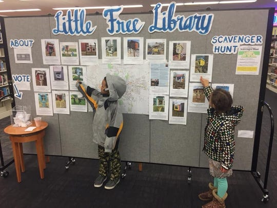 Little Free Library participants choose which library is their favorite to visit in spring of 2018 at the Iowa City Public Library.