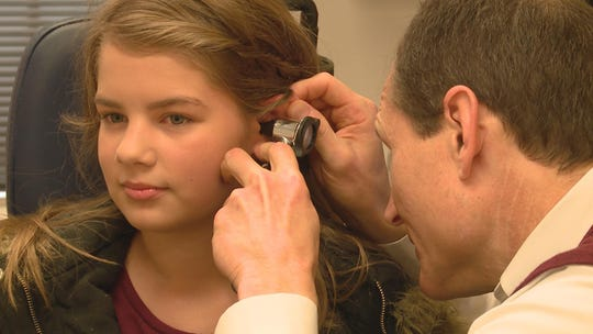 "Knoxville's Dr. John Little examines Addallee Bates' ear on an episode of ""Bringing Up Bates."""