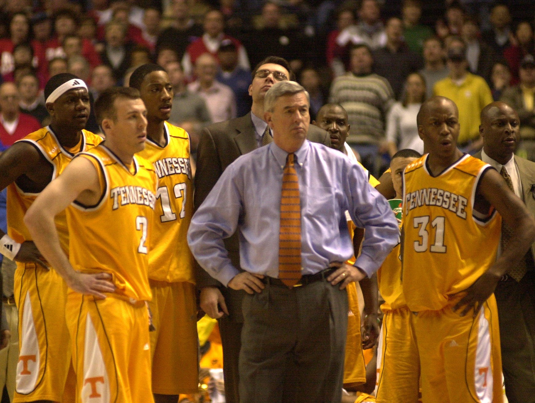 UT Head Coach Jerry Green stands with team players as they wait for a call by referees after Ron Slay was involved in an incident with Ole Miss's #44 Rahim Lockhart. 2001