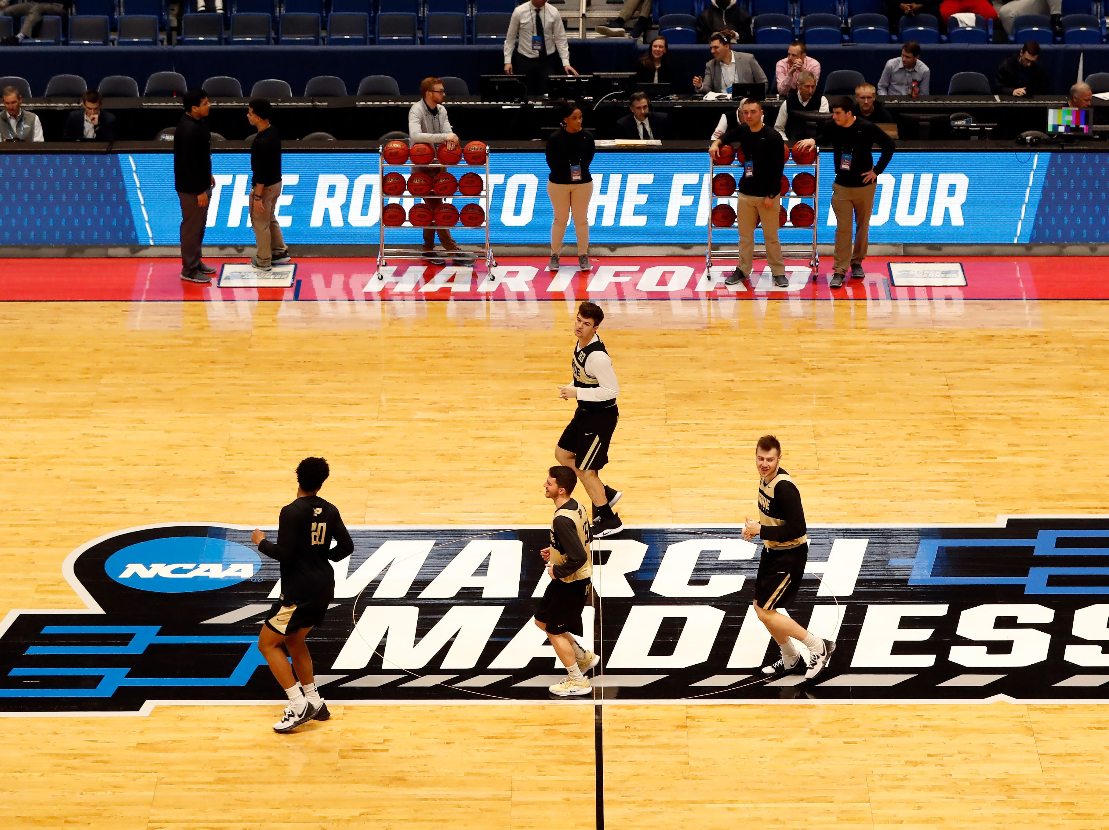 Mar 20, 2019; Hartford, CT, USA; Members of the Purdue Boilermakers run through the March Madness logo during practice before the first round of the 2019 NCAA Tournament at XL Center. Mandatory Credit: David Butler II-USA TODAY Sports