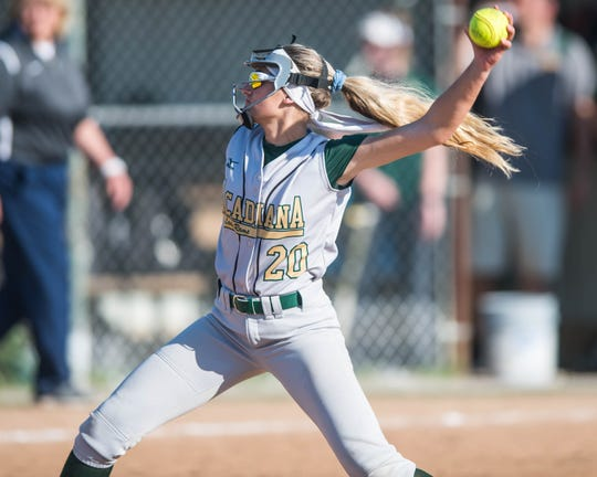 Acadiana High's Brooke Duhon (20)  pitches from the circle in relief as the Acadiana Lady Rams' softball team plays host to the Comeaux Lady Spartans on Tuesday, March 19, 2019.