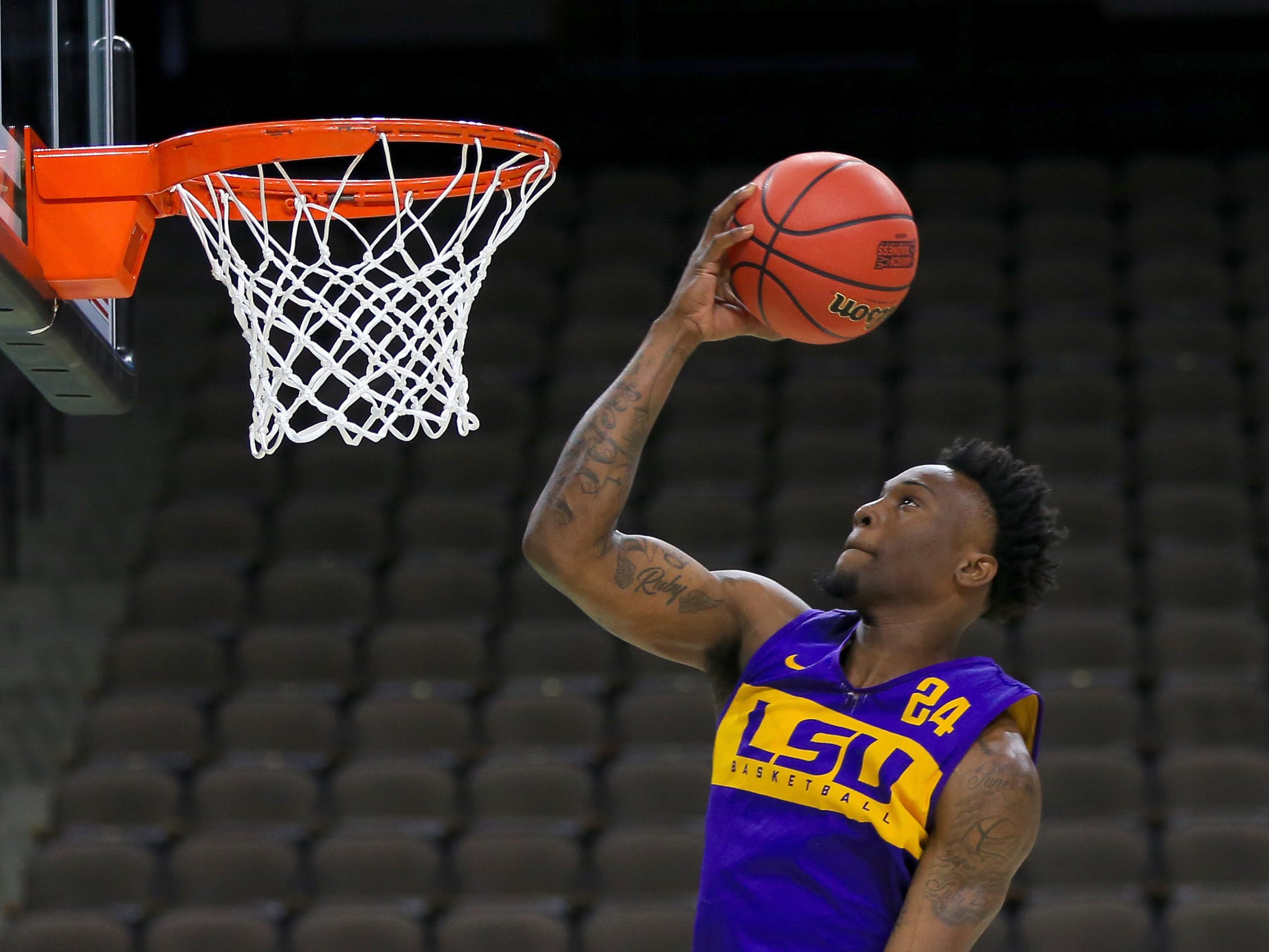 March Madness: LSU's Emmitt Williams crashes into press row