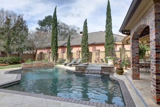 The inviting pool and outdoor spaces are perfect for entertaining.
