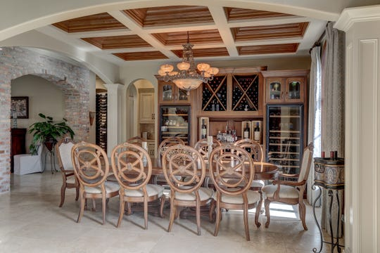 The formal spaces include an elaborate wine cellar.