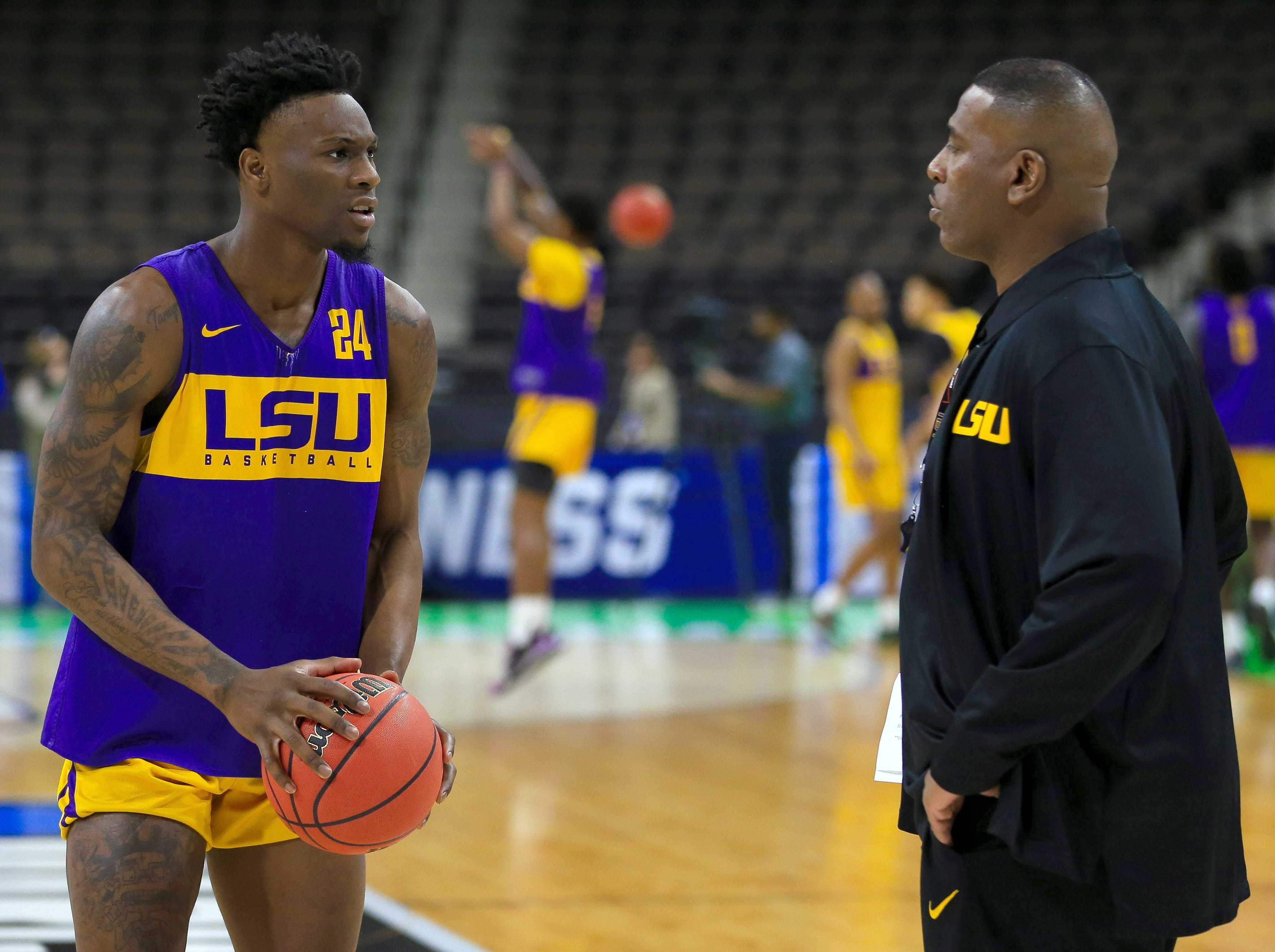 Mar 20, 2019; Jacksonville, FL, USA; LSU Tigers interim head coach Tony Benford talks with forward Emmitt Williams (24) during practice day before the first round of the 2019 NCAA Tournament at Jacksonville Veterans Memorial Arena. Mandatory Credit: Matt Stamey-USA TODAY Sports