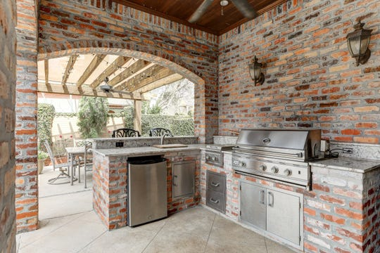 There is plenty of space for outdoor cooking and dining.
