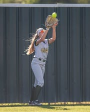 Acadiana High's Brooke Duhon makes the catch in left field for the second out as the Acadiana Lady Rams' softball team plays host to the Comeaux Lady Spartans on Tuesday, March 19, 2019.