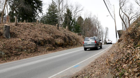 Vehicles drive through rocky slops along the edges of Ohio 37 Wednesday, March 20, 2019, north of Rising Park in Lancaster. Beginning April 22 the Ohio Department of Transportation plans to close to the highway for 21 days in order to cut back some of the rocky walls.