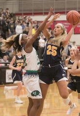 Whitney Sollom (25) had 11 points and 21 rebounds for Hartland in a 37-26 victory at Saginaw Heritage.