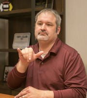 Todd Morrison, SignIFICANT founder and president talks Wednesday, March 20, 2019 using American Sign Language discussing the challenges people who are deaf or have partial hearing loss have in the workplace.