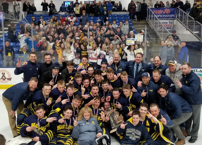Hartland celebrates a second straight state Division 2 hockey championship on Saturday, March 9, 2019 at USA Hockey Arena.